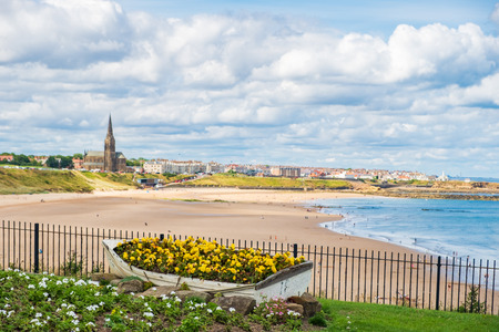 Summer scene of Ornamental Boat containing Flowers, with Tynemouth's Coastline in the background