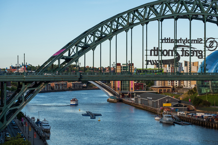 Newcastle, England - August 2, 2018: Newcastle city Skyline with Tyne Bridge in view at Newcastle Quayside on a summer afternoon