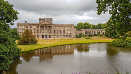 Lyme Hall and its pond. It is a historic English stately home inside Lyme Park in Cheshire, England.