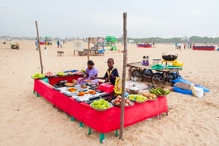 Chennai, India - September 6, 2007: A young man and a woman cooking and selling food on Marina beach in Chennai.