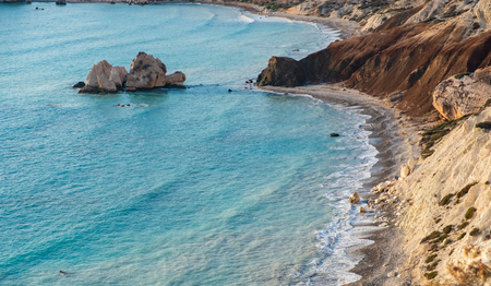 Bird's eye view of Petra tou Romiou rock on a beautiful afternoon, considered to be Aphrodite's birthplace in Greek mythology. This is a famous tourist travel destination landmark in Paphos, Cyprus.