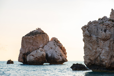 Afternoon view of the seascape around Petra tou Romiou, in Paphos, Cyprus. It is considered to be Aphrodite's birthplace in Greek mythology.
