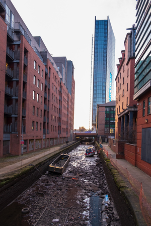 View of the Rochdale canal in Manchester, England seen here emptied of water. Overall it is a navigable broad canal in between Manchester and Sowerby Bridge Banco de Imagens