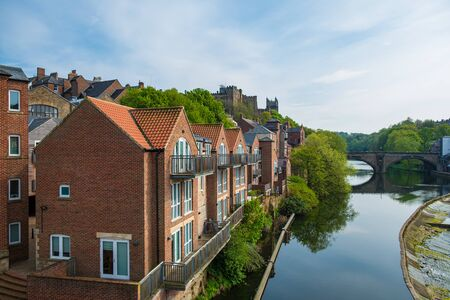 Traditional buildings along the bank of River Wear in Durham, United Kingdom Stock Photo