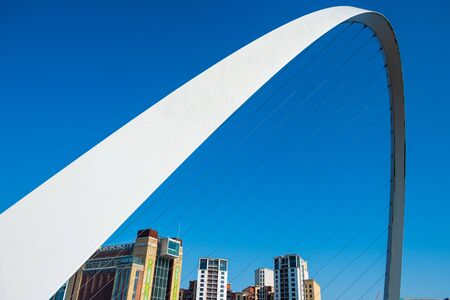 Newcastle, United Kingdom - April 29, 2019: Gateshead Millennium Bridge and the Baltic Centre for Contemporary Art . The bridge spans the River Tyne in north east England. Editorial
