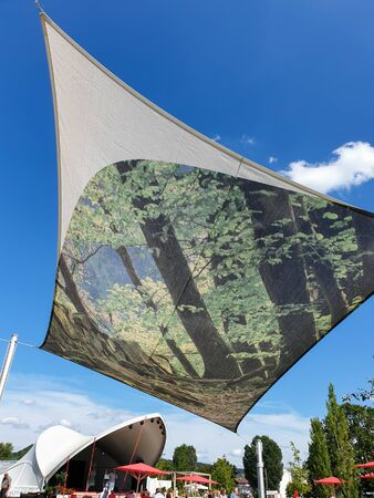Heilbronn, Germany - August 8, 2019: View of a suspended tent and open air concert at the 2019 Federal Garden Show BUGA in Heilbronn, Germany