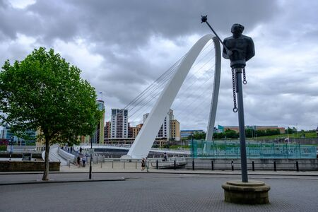 Newcastle, United Kingdom -June 30, 2019: Modern sculpture, the Millennium Bridge and Baltic Centre for Contemporary Art landmarks at Newcastle Quayside