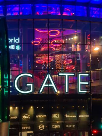 Newcastle, United Kingdom -July 2, 2019: Exterior evening capture of the illuminated entrance to the Gate entertainment complex in Newcastle, Tyne and Wear.