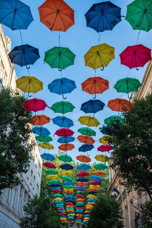 Liverpool, United Kingdom - July 18, 2019: Suspended umbrellas, part of a charity fundraiser for ADHD awareness  in Church Alley, Liverpool, UK.
