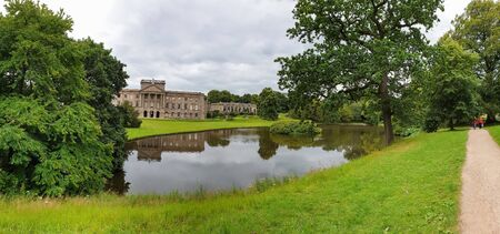 Stockport, United Kingdom - July 21, 2019: Panoramic view of Lyme Hall historic English Stately Home and park in Cheshire, UK