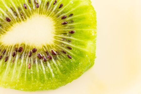 Kiwi fruit cut in half. Suitable as a Background