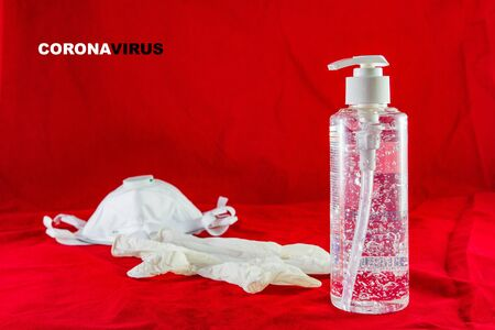 Sanitizing gel, white latex gloves, and mask on red. Protection concept against pollution, virus, flu and coronavirus. Copy space