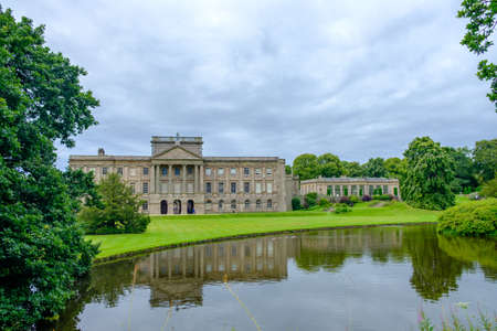 Stockport, United Kingdom - July 21, 2019: Lyme Hall historic English Stately Home and park in Cheshire, UK with people enjoying themselves in the gardens Editorial
