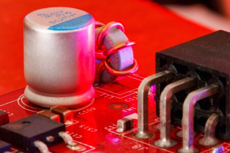 Electronic Printed Circuit Board with Electronic components in red viewed form above and sideways Stok Fotoğraf