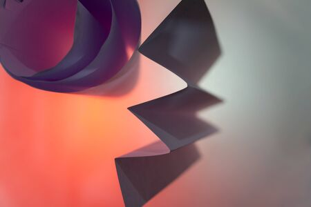 Folded backlit paper abstract shapes suitabe as wallpaper. Shallow depth of field. Stok Fotoğraf