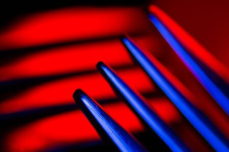 Prongs of one fork in colorful illumination macro shot creating an abstract composition. Image is suitable as a background. Stok Fotoğraf