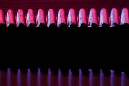 Edge of an illuminated  serrated knife and their reflection macro shot. Image suitable as a background. Stok Fotoğraf
