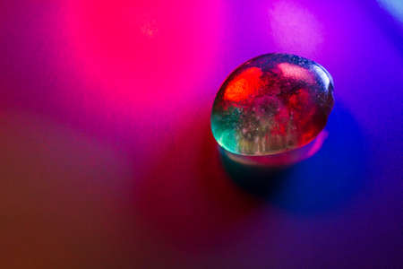 Tumbled mineral gem colorfully illuminated showing abstract details. Stok Fotoğraf
