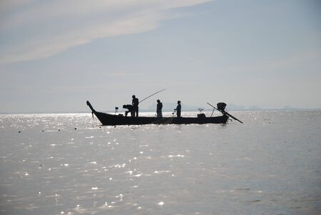 southern of thailand: Fishermen on the sea in the morning, Rai lay bay, Krabi province, Southern Thailand Stock Photo