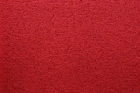 floor mat: red pvc floor mat Stock Photo