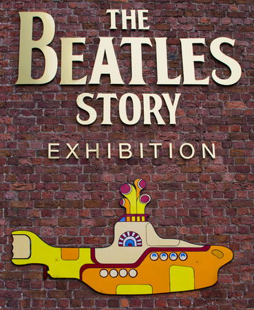 Liverpool, UK - June 14, 2014: A sign for The Beatles Story Exhibition in Liverpool on 14th June 2014