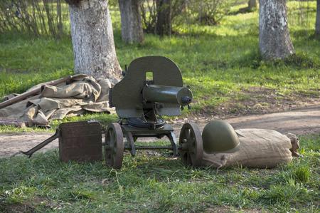 machine gun: Old Machine gun Maxim system, with cartridges and a helmet