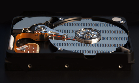 hard component: Hard disk for a computer on a dark background