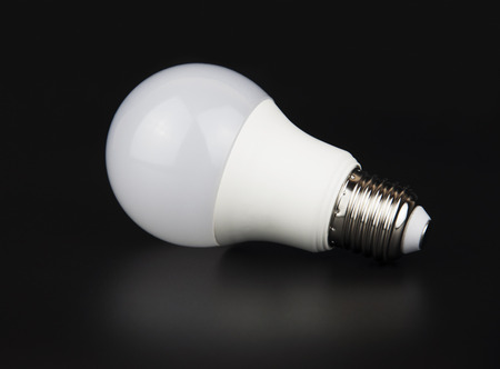 electric material: White LED bulb with reflection on black background