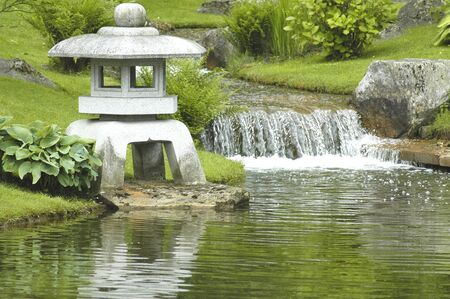 wooden bridge and stone lantern at japanese garden stock photo 1140373
