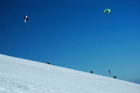 snowkiting: Two man Snowkiting on mountain Stock Photo