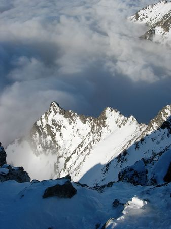 High Tatra, dramatic shot over the cloud formed by a temperature inversion Stock Photo - 1229915