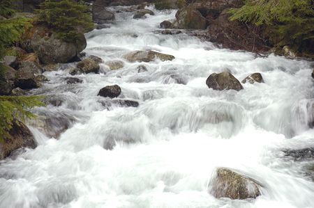 creeks: Water running down the hill Stock Photo