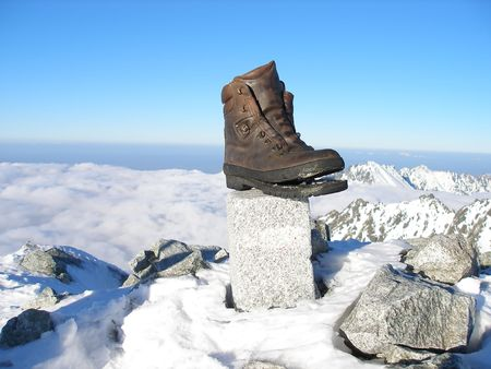 Old weather shoe forgotten on top of mountain photo