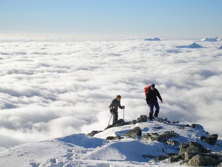 alpinism: Two hikers on top of peak Stock Photo