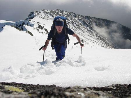 Tourist climber on top of mountain Stock Photo - 1320929