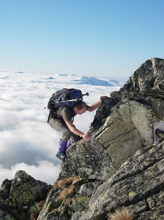 Mountainer on his way to top of peak photo