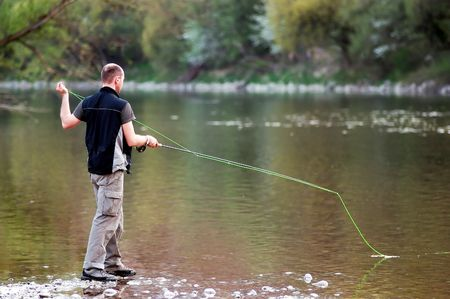 Fisherman angling on the river Stock Photo - 1327002