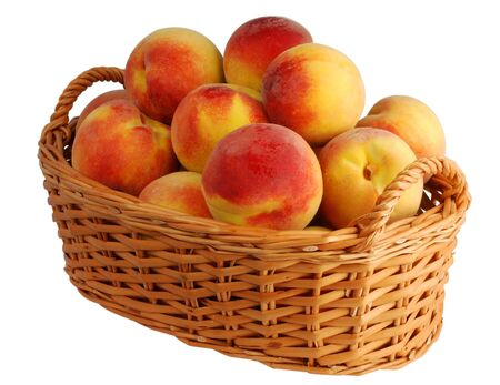 Basket full of fresh peaches isolated on white background Stock Photo