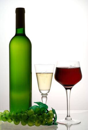 Red and white wine opposite white light photo