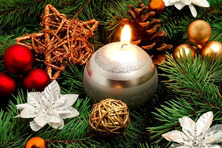 White candle and christmas decorations