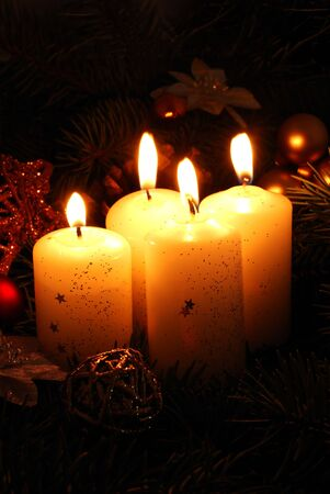 Four white candle and christmas decorations