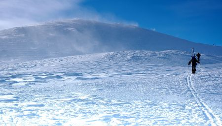 Skiers climning on top of mountain Stock Photo - 2137423