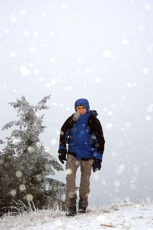 soft hail: Tourist walking on path during snowfall Stock Photo