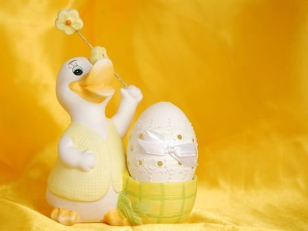 sateen: Easter egg on golden sateen background Stock Photo