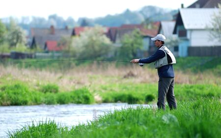 Fisherman angling on the river Stock Photo - 3063334