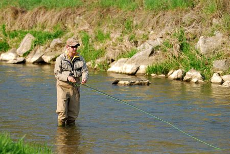 Fisherman angling on the river Stock Photo - 3063336
