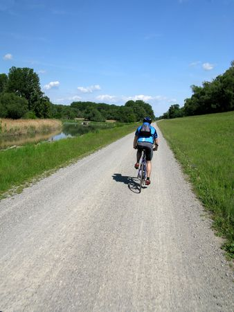 Road Cyclist in the country on a summer day.
