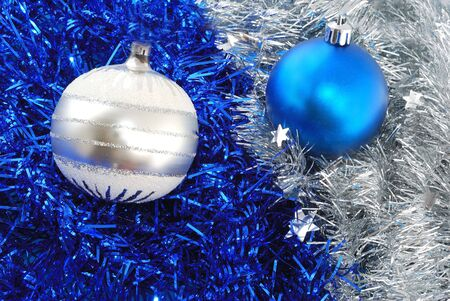 unlike: Christmas balls decorations on tinsel Stock Photo