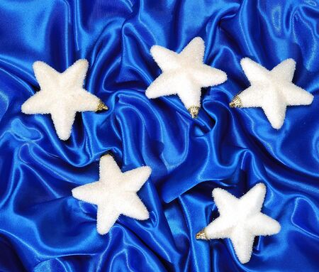 sateen: Christmas decoration on blue sateen with big stars Stock Photo
