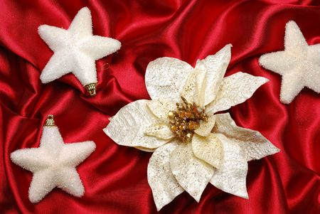 sateen: Christmas decoration on red sateen with  flower and stars  Stock Photo
